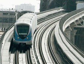 A track-checking car runs on the Dubai Metro stretch along Shaikh Zayed Road opposite Dubai Marina. Metro officials claim the Red Line is on schedule to meet the opening deadline of September 9.