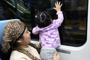 A young girl rides the Dubai Metro near the Deira City Centre in Dubai on September 12, 2009. Randi Sokoloff / The National