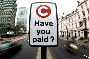 A congestion charge payment reminder sign in the UK. The fee was imposed to encourage the use of public transport. Alessia Pierdomenico / Reuters