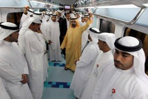 Sheikh Mohammed bin Rashid, Vice President of the UAE and Ruler of Dubai, rides on the inaugural journey of the Green Line, the rail system's second line after the Red Line opened exactly two years ago.  AFP PHOTO/KARIM SAHIB