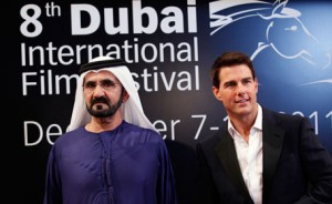 "His Highness Sheikh Mohammed bin Rashid Al Maktoum ((L), Vice-President and Prime Minister of the UAE and Ruler of Dubai, poses at the red carpet with US actor Tom Cruise as they arrive during the opening ceremony of the 8th Dubai International Film Festival for the premiere of Cruise's new movie ""Mission Impossible: Ghost Protocol"" December 7, 2011. (REUTERS)"