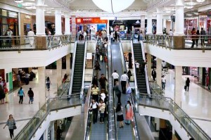 Shoppers such as these at Deira City Centre in Dubai view malls as a source of entertainment and socialising.  Amy Leang / The National
