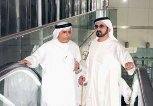 * Shaikh Mohammad enters a station with Mattar Al Tayer. * Image Credit: WAM