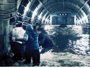 """A handout undated still photo provided by Profit Ltd Russian film-making company shows a scene from """"Metro,"""" a disaster movie which pictures what might happen if Moscow's metro system sprung a leak from the Moscow River flowing above it and a speeding train crashed into a wall of water. — AFP"""