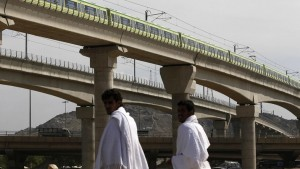 A MakkahMetro train passes over Muslim pilgrims' heads towards Mina ahead of the hajj main ritual at Mount Arafat outside Makkah. (File photo: AP)