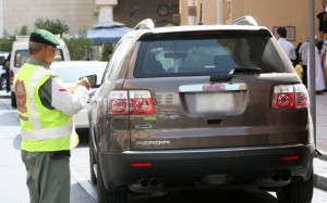 A police officer monitors traffic flow on a street in Dubai, July 30, 2011.    Photo by Mustafa Kasmi