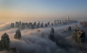 In this Monday, Oct. 5, 2015 file photo, a thick blanket of early morning fog partially shrouds the skyscrapers of the Marina and Jumeirah Lake Towers districts of Dubai, United Arab Emirates. Dubai's rapid transformation from a desert outpost into one of the world's most architecturally stunning cities is mapped out in the Marina. Where just 15 years ago there was empty, flat land, today a bustling neighborhood thrives centered around a canal and an impressive skyline that pierces through the clouds. (AP)