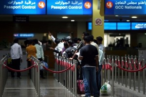 People wait in line at the passport control area in Terminal 1 arrivals section at the Dubai International airport. Tens of thousands of passengers are expected to travel through Dubai airport this week. Randi Sokoloff / The National