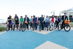 Patrizio Fondi, fifth right, European Union ambassador to the UAE, is joined by other ambassadors and staff members from 13 EU embassies on the Corniche on Tuesday to cycle to work. Christopher Pike / The National