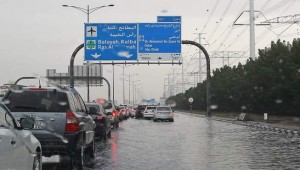 Traffic moves at a snails pace on Al Khan Road that was flooded due to the sudden downpour that occurred on Tuesday morning. - Photo by Juidin Bernarrd